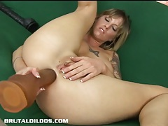 Tatted up tricia swallowing a thick dildo with her ass tubes