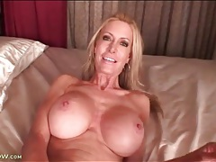 Fit mature with sexy fake tits masturbates tubes