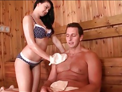 Sexy brunette washes and blows him in the sauna tubes
