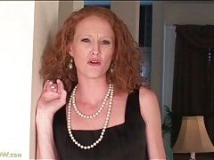Skinny redhead milf strips off her little black dress tubes