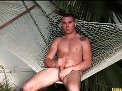 Hot guy sits in a hammock and masturbates tubes