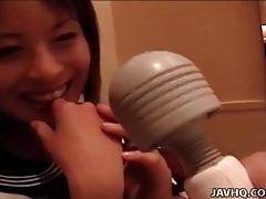 Smiling japanese teen schoolgirl solo tubes