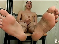 Cute shaved head guy models soft feet tubes