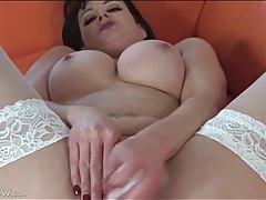Momma wears white stockings as she fucks a toy tubes