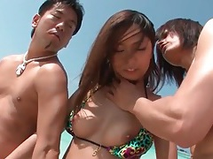 Beautiful bikini girl on the beach groped by guys tubes