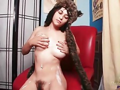 Hairy cunt girl in a fuzzy cap masturbates solo tubes