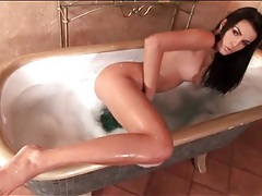 Wet naked brunette beauty masturbates in bathtub tubes