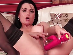 Brunette milf beauty fucks wet pussy with toy tubes
