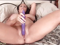 Purple toy turns on cunt of a big tits milf tubes