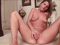 Tiny titties on a mature rubbing her clitoris tubes