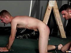 Bound bottom deepthroats dick and eats ass tubes