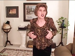 Mature talks to camera and strips her clothes off tubes
