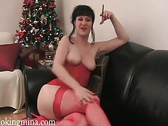 Red corset and stockings on smoking beauty tubes