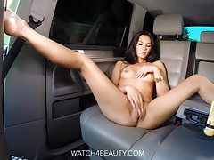 Hot sporty brunette masturbating on a car and on a boat tubes