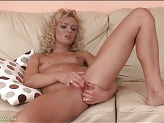 Beauty with curly blonde hair masturbates tubes