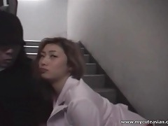 Asian sucks off a dick in the stairwell tubes