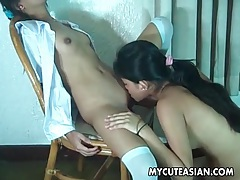 Cute asian lesbian gently licks shaved pussy tubes