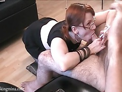 Redhead in a skirt and boots sucks off his dick tubes