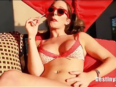 Busty chick in sunglasses sucks on a lollipop tubes