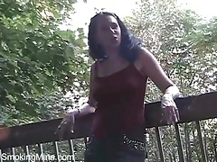 Outdoor upskirt tease with a sexy smoking girl tubes