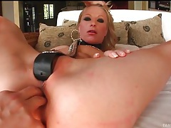 Blonde slut with belt around her neck sucks cock tubes