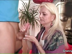 Granny gives a handjob and gets him hard tubes