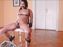 Beauty bound by leather straps pisses lustily tubes