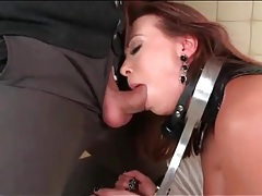 Leather girl in bondage gets fucked in the butt tubes
