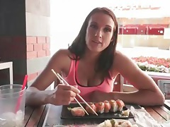 Misty anderson eats sushi at an outdoor restaurant tubes