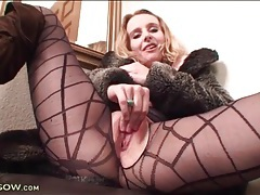 Blonde in beautiful black pantyhose fingers her cunt tubes