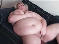 Bbw bangs her bald pussy with a black dildo tubes