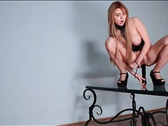 Black toy up the asshole of girl in leather corset tubes