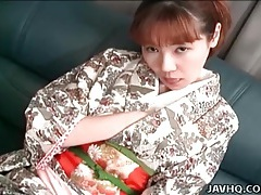 Young japanese girl in kimono teases her hot pussy tubes