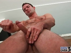 Pouring morning coffee and masturbating his cock tubes