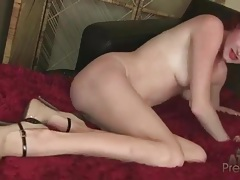 Redhead fondles her little tits and teases her pussy tubes