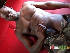 Sexy solo black guy masturbates his lubed cock tubes