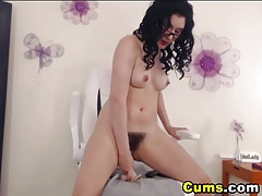 Busty glasses babe rides her dildo tubes