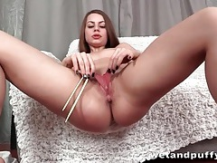 Cutie opens her pussy with a speculum tubes