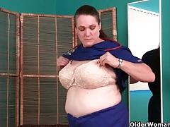 Busty grandma in nurse uniform and stockings masturbates tubes