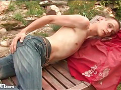 Skinny guy strips in the shade and strokes outdoors tubes