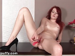 Sexy masturbating redhead pees on the floor tubes
