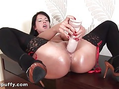 Thick dildo fucks wet pussy of chick in stockings tubes