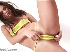 Tiny yellow see through bikini on brunette tubes