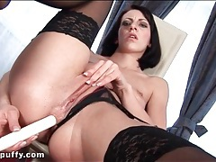 Stockings girl fucks pussy and ass with a candle tubes