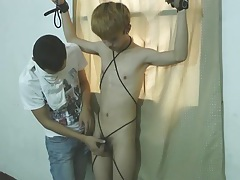 Handsome asian slave boy bound milked tubes