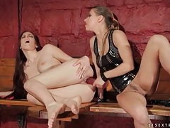 Redhead rides dildo as her mistress watches tubes