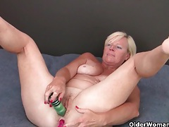 Grandma pushes a dildo up her ass and pussy tubes