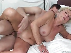 Hairy granny pussy rides a young cock tubes