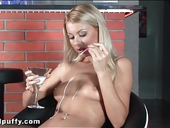 Beautiful young blonde drips milk on her body tubes
