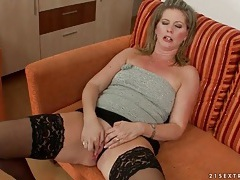 Hot milf in tube top and stockings fucks toy tubes